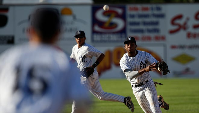East Cobb Yankees' Xzavion Curry throws to first to complete an out against the Dallas Tigers on Wednesday in Game 19 of the Connie Mack World Series at Ricketts Park in Farmington.