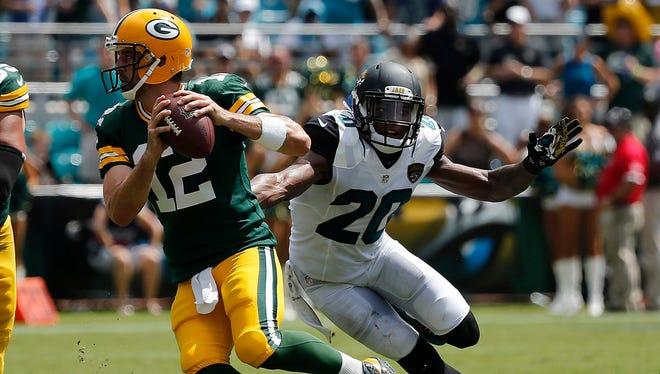 Jacksonville Jaguars cornerback Jalen Ramsey (20) pressures Green Bay Packers quarterback Aaron Rodgers (12) during the first half at EverBank Field.