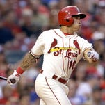 St. Louis Cardinals' Kolten Wong follows through on a two-run ground-rule double against the Chicago Cubs on Saturday.