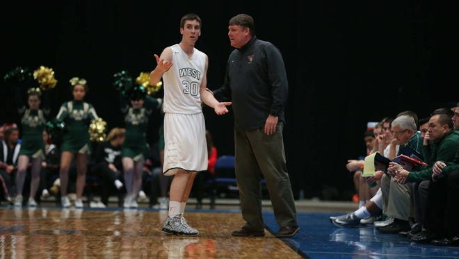 Iowa City West's Connor McCaffery talks to his coach Steve Bergman while a teammate shoots a free-throw in the substate final game on Tuesday, March 3, 2015 in the U.S. Cellular Center. Iowa City West beat Cedar Rapids Washington 79-50.