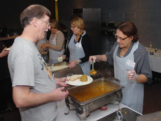 Carl Gearns gets a helping of gravy from volunteer