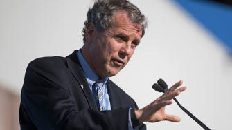 Sen. Sherrod Brown, D-Ohio, speaks during the grand opening of the Fuyao Glass America plant, Friday, Oct. 7, 2016, in Moraine, Ohio. The Chinese company is ready to show off its completed automotive glass-making plant in Ohio, which serves as its North American hub for recycled glass manufacturing. (AP Photo/John Minchillo) ORG XMIT: OHJM107