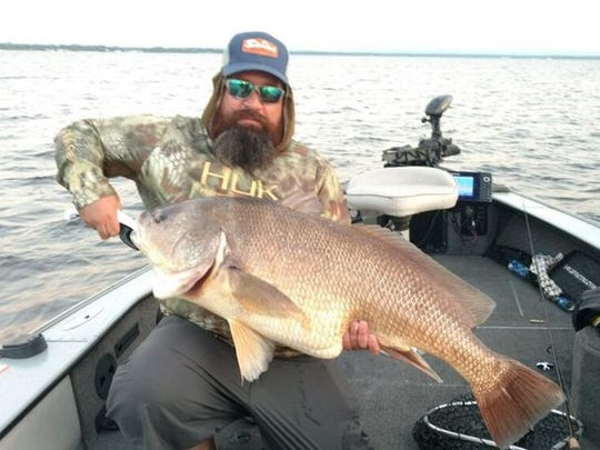 Jason Bair, Macedon, with his state record freshwater drum caught June 16 on Oneida Lake. The fish measured 42.75 inches and weighed 36 pounds.