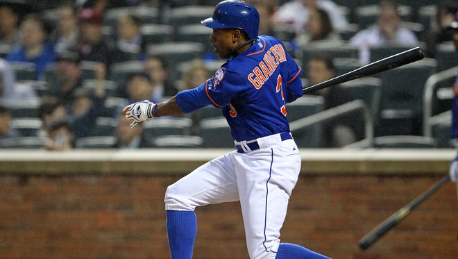 New York Mets right fielder Curtis Granderson (3) hits an RBI double against the Philadelphia Phillies during the first inning at Citi Field.