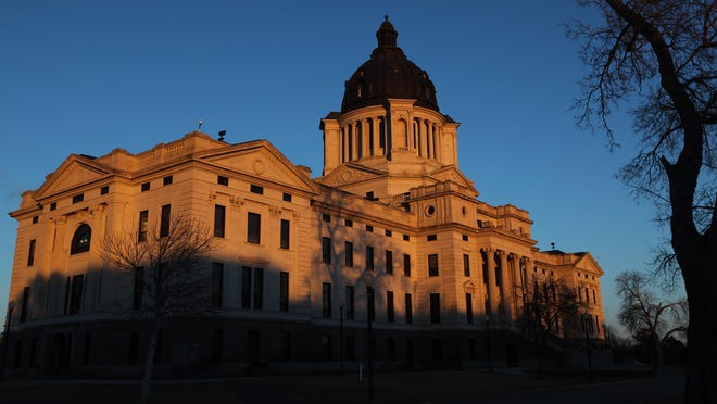 The setting sun paints the front side of the South Dakota State Capitol in Pierre on Tuesday, Feb. 23, 2016.