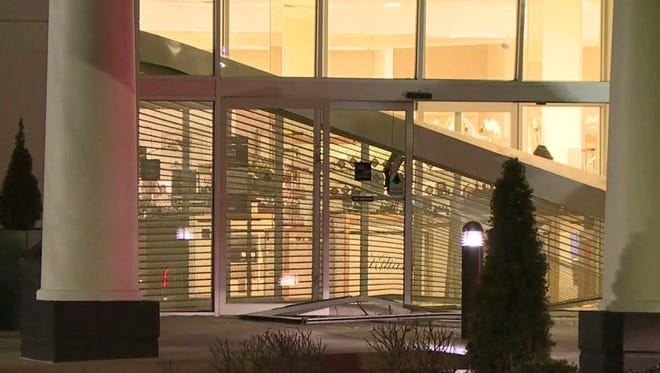 A car struck entry doors Monday at Saks Fifth Avenue at the Fashion Mall at Keystone.