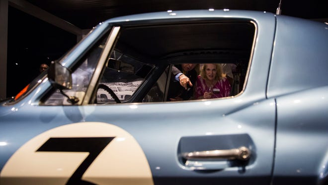 "Nancy Mardsen looks through the window of the 1963 Corvette Grand Sport during the ""Duntov's Stealth Fighters"" reveal party at The Revs Institute in Naples on Friday, April 6, 2018."