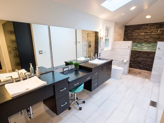 The renovated bathroom, which features improved accessibility,
