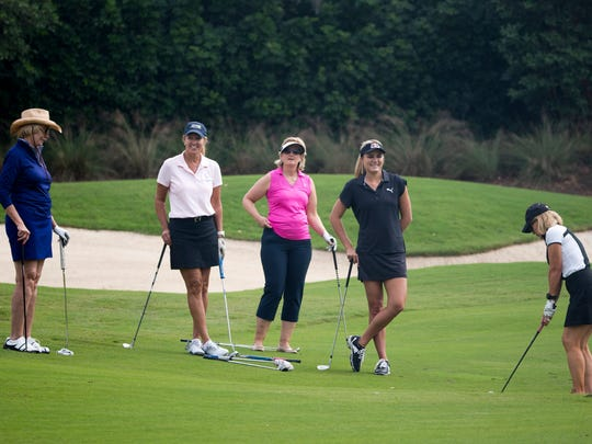 LPGA Tour Pro and 2016 Olympian Lexi Thompson, second from right, shares a laugh with her group during the Immokalee Foundation Charity Classic at Bay Colony Golf Club Monday, Nov. 14, 2016 in Naples.