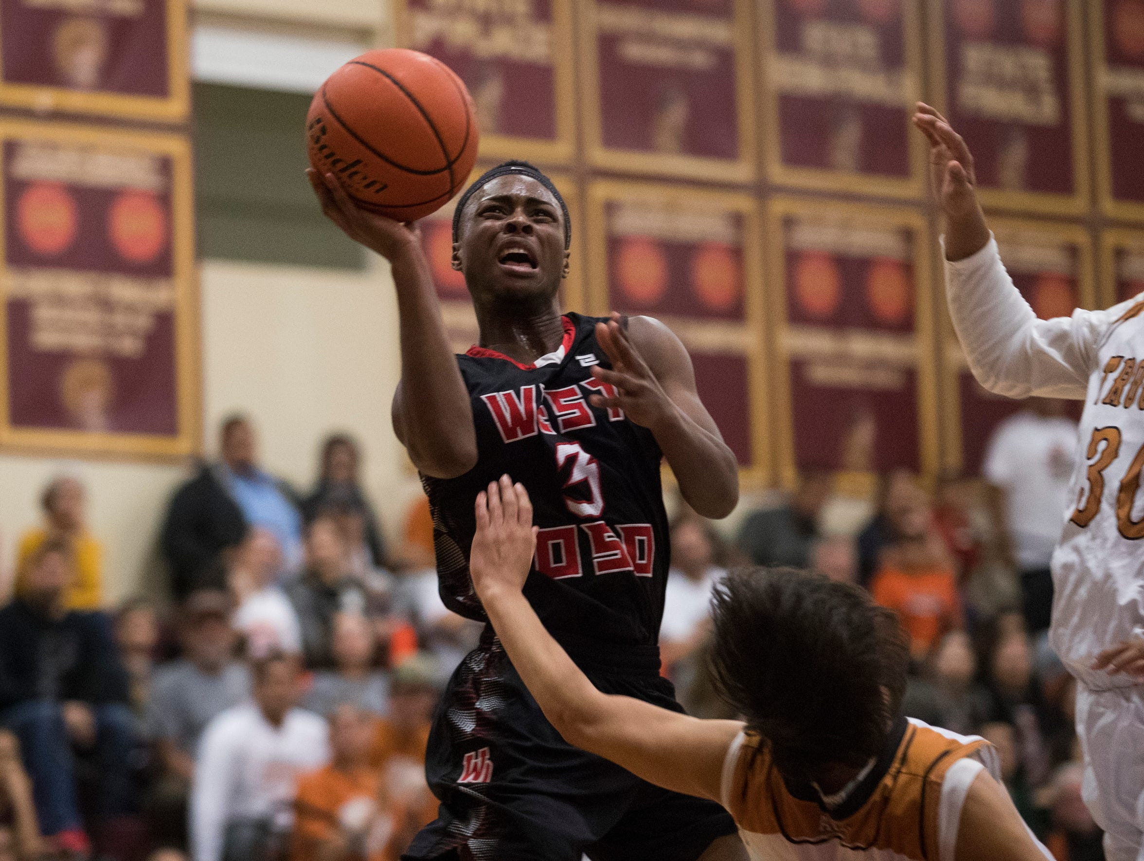 West Oso's Creighton Avery shoots the ball past Beeville