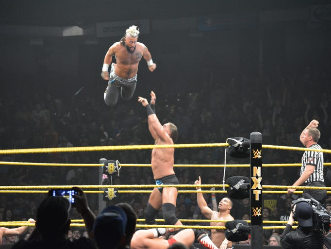 WWE wrestler Enzo Amore flies high over his opponent