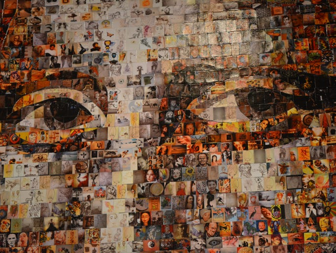 An artists captures the iconic Mona Lisa with jigsaw