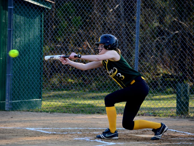 Broadwater's Heather Custis bunts the ball during the