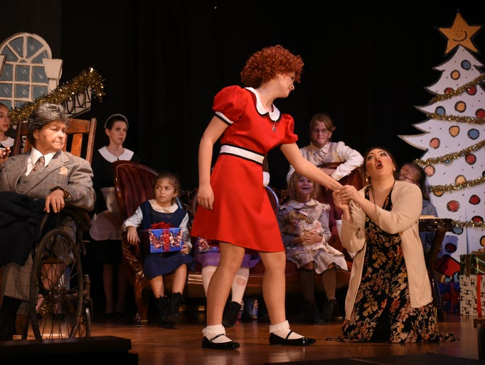 Annie reminds Miss Hannigan she was taught not to lie.