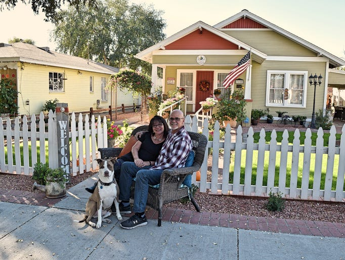 Owners Jim and Xan Hummel, with dog, Pringle, in front