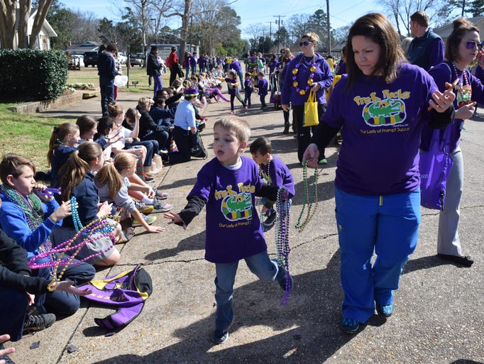 Julie Simmons (right) guides her son Konnor Simmons,