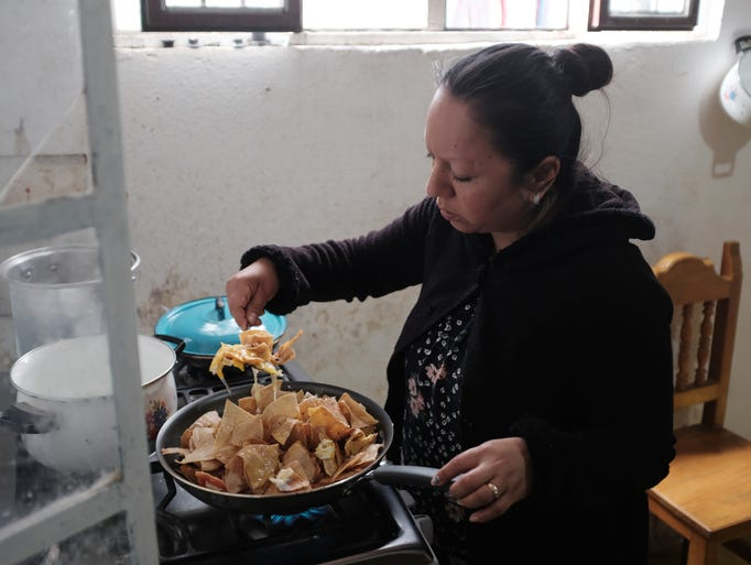 Guadalupe Garcia de Rayos, 36, cooks breakfast at her