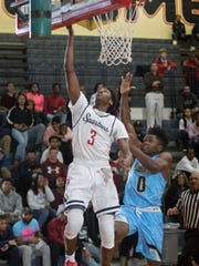 Ferontay Banks scores on a lay up as Madison Prep's