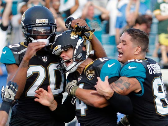 Jacksonville Jaguars kicker Josh Lambo, center, celebrates