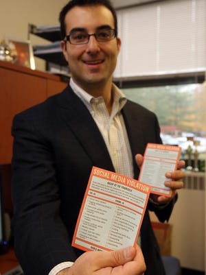 Christopher Salute, who teaches a social media course at Mercy College, shows the social media notes he gives his students in his office in Dobbs Ferry, N.Y.
