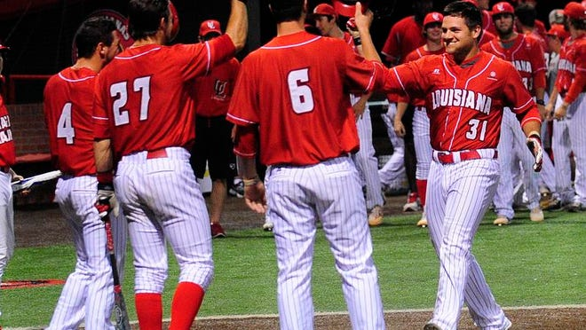 UL utility player Evan Powell (31) celebrates at home plate with shortstop Blake Trahan (4), outfielder Seth Harrison (27) and catcher Nick Thurman (6) after Powell hit a home run during the Cajuns' 16-0 demolition of Tulane.