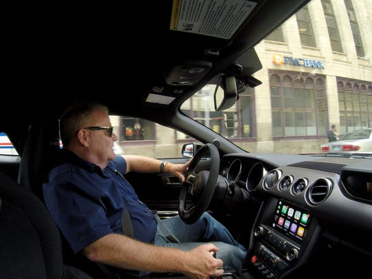 Detroit Free Press auto critic Mark Phelan drives a 2017 Ford Mustang GT350 on Woodward Avenue towards the DIA as part of the Free Press' Great QLINE Race in Detroit last month.