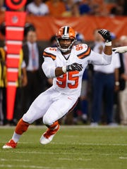 FILE - In this Aug. 21, 2017, file photo, Cleveland Browns defensive end Myles Garrett (95) plays against the New York Giants during the first half of an NFL preseason football game, in Cleveland. Browns rookie defensive end Myles Garrett will be sidelined for weeks a sprained right ankle. The top overall pick in this year's draft got hurt in practice on Wednesday, Sept. 6, 2017, while the Browns were having their first full practice in preparation for Sunday's season opener against the Pittsburgh Steelers. (AP Photo/Ron Schwane, File)