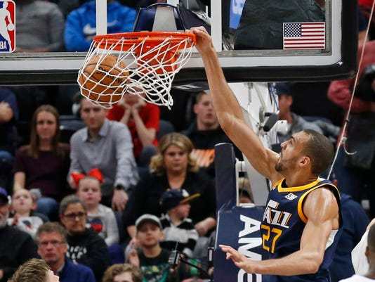 Utah Jazz center Rudy Gobert (27) dunks against the Orlando Magic in the first half during an NBA basketball game Monday, March 5, 2018, in Salt Lake City. (AP Photo/Rick Bowmer)