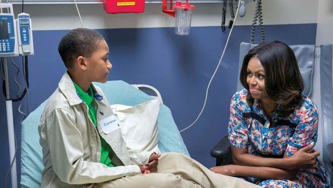 Mrs. Obama visits Camron Stevens in his room at St. Jude Children's Research Hospital, Sept. 17, 2014.