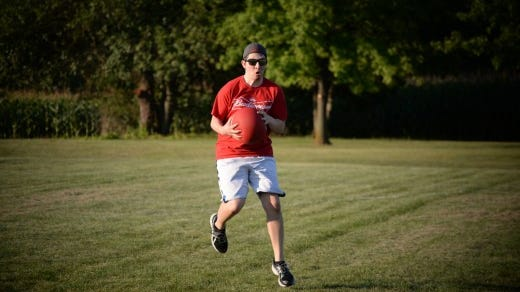 YDR staffer Will Hanlon catches a ball during the game. (Shane Dunlap - Evening Sun)
