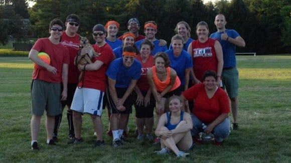 Daily Record and Evening Sun journalists pose after a well-fought game.