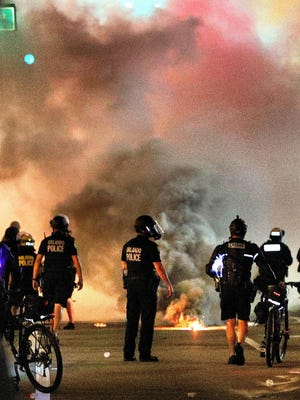 Orlando Police deploy tear gas on protesters at Orlando City Hall in downtown Orlando, Fla., on June 2, 2020. Large crowds of demonstrators gathered again at locations throughout the city to protest the police killing of George Floyd in Minneapolis on May 25.
