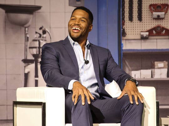 Super Bowl champion, Emmy-winning talk show host, and new Good Morning America cohost Michael Strahan speaks with local news anchor Carolyn Clifford during Fuel:Detroit, a one-day leadership conference at the Soundboard in the Motor City Casino Hotel in Detroit on Thursday, April 21, 2016.
