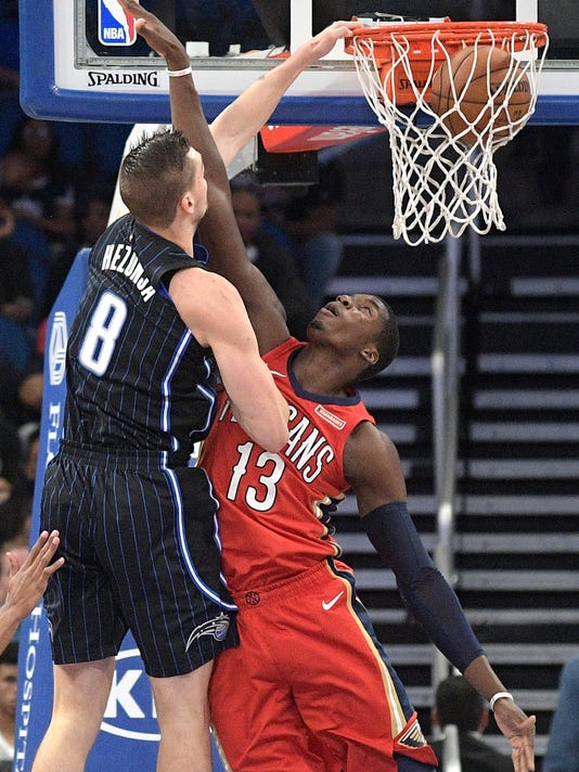 Orlando Magic guard Mario Hezonja (8) dunks over New Orleans Pelicans forward Cheick Diallo (13) during the second half of an NBA basketball game Friday, Dec. 22, 2017, in Orlando, Fla. The Pelicans won 111-97. (AP Photo/Phelan M. Ebenhack)