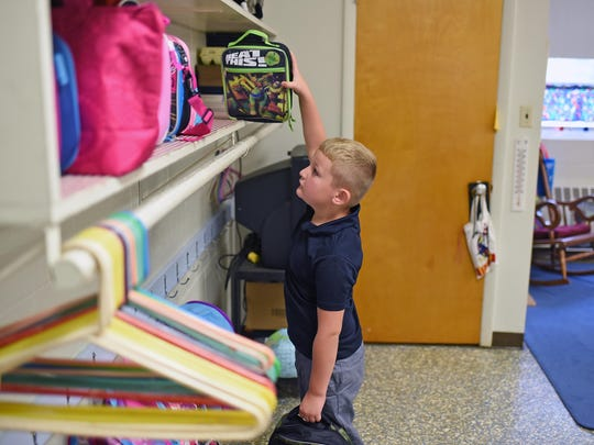 Niko Pace, a 1st grader of Cumberland Christian School put away his lunch bag and book bag on the 1st day of school. Sept. 2, 2015. Staff photo/Craig Matthews