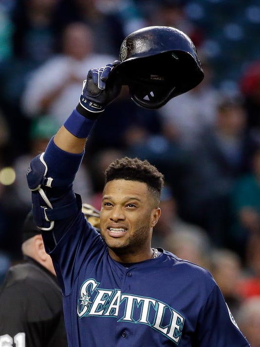 Seattle Mariners' Robinson Cano turns away from the plate and stretches after called strike as he batter in the first inning of a baseball game against the Texas Rangers on Tuesday, Sept. 6, 2016, in Seattle. Cano popped out on the at-bat. (AP Photo/Elaine Thompson)