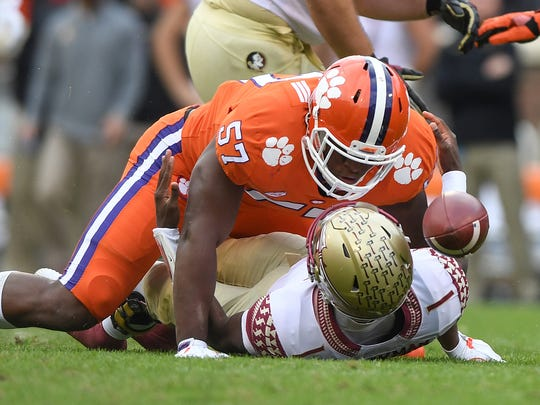 Clemson linebacker Tre Lamar (57) recovers a fumble by Florida State quarterback James Blackman (1)after sacking him during the 1st quarter on Saturday, November 11, 2017 at Clemson's Memorial Stadium.