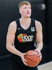 Iggy Brazdeikis participates in practice at the Hoop
