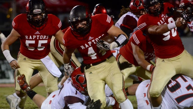Ravenwood senior Connor Jeffries breaks free from an Overton defender during the first half of the Class 6A playoff game against Overton on Friday, November 13, 2015.