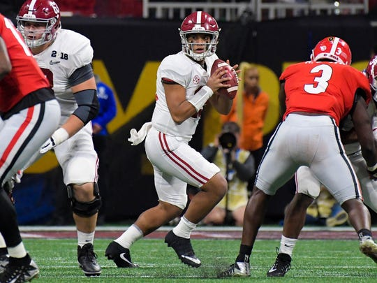 Alabama  quarterback Tua Tagovailoa looks to pass against