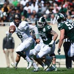 White team quarterback Damion Terry (6) scores a touchdown during the Green and White Spring Game on Saturday, April 23, 2016 at Spartan Stadium. The White team won.