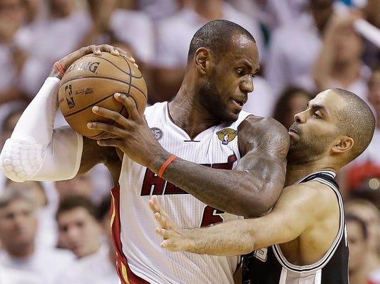 FILE - In this June 18, 2013 file photo, San Antonio Spurs point guard Tony Parker, right, and Miami Heat small forward LeBron James collide during the second half of Game 6 of the NBA Finals in Miami.  A rematch of last year's thrilling NBA Finals finish is possible, but the Spurs and Heat would have to get through tough paths to get there.  (AP Photo/Lynne Sladky, File)