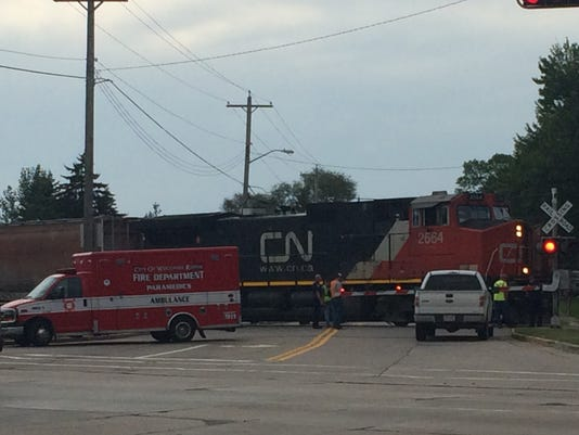 Teen hit by train