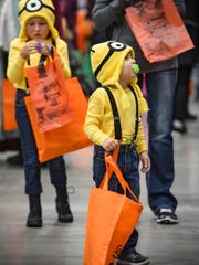 Mason and Chloe Amiot are dressed as Minions during the Kids & Parents Expo Saturday, Oct. 28, at the River's Edge Convention Center in St. Cloud.