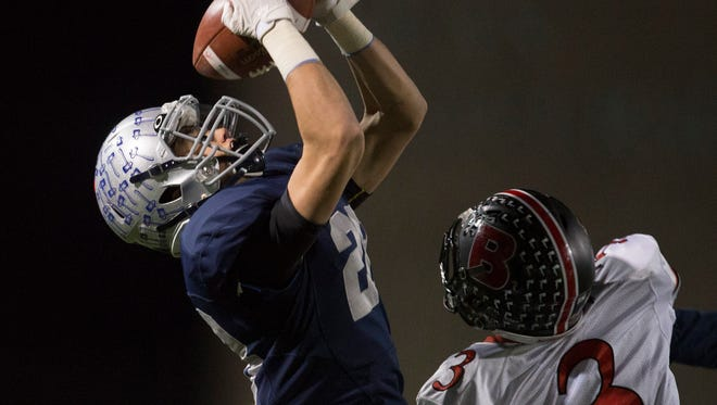 Manasquan's James Pendergist catches a long pass down the sideline against Bernard's Ethan Caldwell to set up his team's first touchdown of game. Bernards vs. Manasquan in Central Group II football championship football game at Kean University in Union, NJ