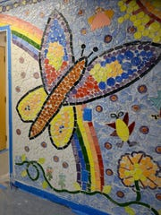 A butterfly in the new mosaic at Holly City Family