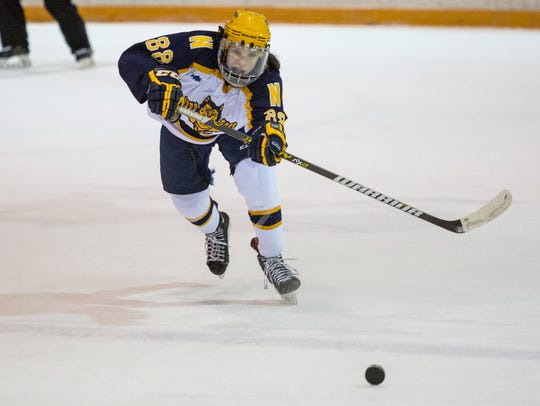 Port Huron Northern sophomore Noah McNutt passes the