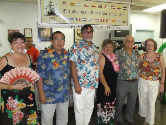 Celebrating birthdays at the Luau were, from left, Yvonne Modesto, José Mori, Roberto Veléz, Carly Werhly, Joe Abbate and Karen Diamond.