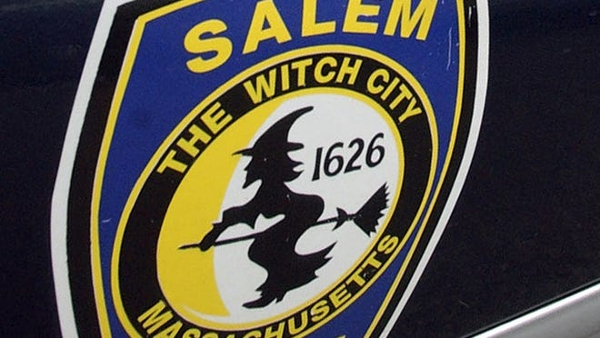 In this file photo, the logo for the Salem Police Department, which bears an image of a witch, is displayed on a police cruiser's door in Salem.