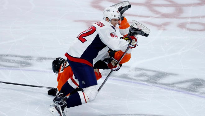Washington Capitals' Evgeny Kuznetsov, front, and Philadelphia Flyers' Shayne Gostisbehere collide during the third period of Game 3 in the first round of the NHL Stanley Cup hockey playoffs, Monday, April 18, 2016, in Philadelphia. Washington won 6-1. (AP Photo/Matt Slocum)